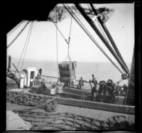 Cargo being unloaded from S. S. Corona as people watch, Santa Monica, about 1898