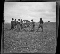 Servicemen loading and prepparing a cannon for firing during a Decoration Day commemoration at Los Angeles National Cemetery, Los Angeles, about 1895