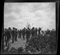 Servicemen perform a gun salute during Decoration Day services at Los Angeles National Cemetery, Los Angeles, about 1895