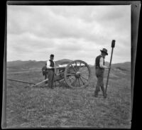Two servicemen stand near a cannon in Los Angeles National Cemetery during Decoration Day, Los Angeles, about 1895