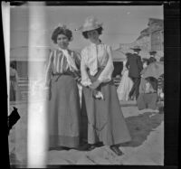 Lizzie Chandler and Nettie Davies stand in the sand, Santa Monica, 1901