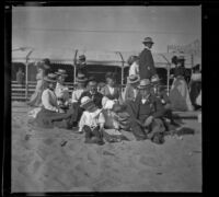 Abraham, Mary, and Mertie Whitaker sit in the sand with William and Josie Shaw, as well as Lelia Gillan and Agnes Hawley, Santa Monica, 1901
