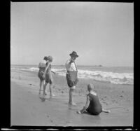 Ade Bystle and Lottie Bystle on the beach, near the water's edge, Santa Monica, about 1920