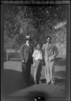 Will H. Shaw, H. H. West, Jr. and Wright Prickett, Jr. pose by the golf course at Sunset Canyon Country Club, Burbank, about 1930