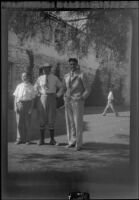 H. H. West, Jr., H. H. West and Wright Prickett, Jr. stand outside the clubhouse at Sunset Canyon Country Club, about 1930