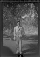 Wright Prickett, Jr. poses in front of a putting green at Sunset Canyon Country Club, Burbank, about 1930
