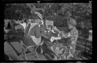 Agnes Whitaker and Mertie West eat at a table at Rock Creek, Mammoth Lakes vicinity, 1940