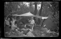 Mertie West and Forrest and Agnes Whitaker stand in their campsite at Rock Creek, Mammoth Lakes vicinity, 1940