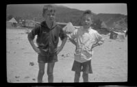 Ambrose Line and H. H. West, Jr. pose at the beach, Topanga, about 1922