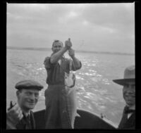 Charles Miles, Guy M. West and an unidentified man pose while fishing near Ocean Park, Santa Monica, about 1910