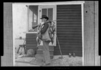 """E. C. """"Dick"""" Taylor holds a gun over his shoulder with ducks hanging from it, Venice, about 1903"""