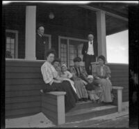 H. H. West's friends and family sit on the porch of his beach cottage, Venice, about 1903