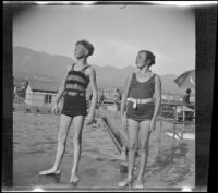 H. H. West, Jr. and Eleanor Shaw standing on a pool's deck at Verdugo Estates, Glendale, about 1930