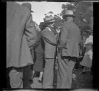 Harry D. Cook speaks to another man at the Iowa Picnic in Lincoln Park, Los Angeles, 1939