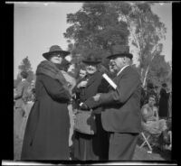 Alice Baltzell Tibbetts, Fannie Mead Biddick, and William Biddick stand together at the Iowa Picnic in Lincoln Park, Los Angeles, 1939