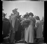 Leta French speaks to other attendees of the Iowa Picnic in Lincoln Park, Los Angeles, 1939