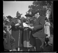 Alice Baltzell Tibbetts, Leta French, and William Biddick stand together at the Iowa Picnic in Lincoln Park, Los Angeles, 1939