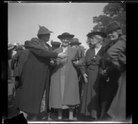 Alice Baltzell Tibbetts speaks to Leta French, Laura Bell Gibson, and another woman at the Iowa Picnic in Lincoln Park, Los Angeles, 1939