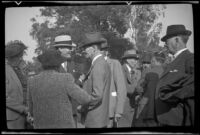 Doc Ashby talks to other attendees of the Iowa Picnic in Lincoln Park, Los Angeles, 1939