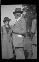 Ralph Hiatt speaks to a woman at the Iowa Picnic in Lincoln Park, Los Angeles, 1939
