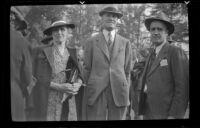 Nellie Hiatt with two men at the Iowa Picnic in Lincoln Park, Los Angeles, 1940