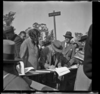 Roy E. Breese signs the register at the Iowa Picnic in Lincoln Park, Los Angeles, 1940