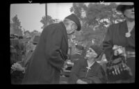 Mrs. Stover sits on a bench at the Iowa Picnic at Lincoln park, Los Angeles, 1940