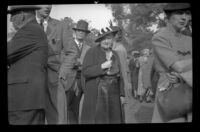 Ralph Hiatt stands behind other attendees of the Iowa Picnic in Lincoln Park, Los Angeles, 1940