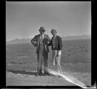 H. H. West and Mertie West pose along the roadside, Wells vicinity, 1942