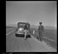 Mertie West and Staff Sergeant John H. Frame of Camden stand on the roadside, Wells vicinity, 1942