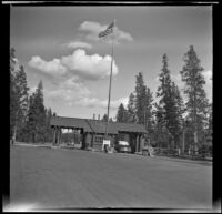 Cars passing through the west entrance of Yellowstone, Yellowstone National Park, 1942