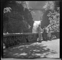 P. F. C. Ernest T. Lewis, Mrs. Ray Johnson and Mertie West pose in front of the lower Multnomah Falls, Multnomah Falls, 1942
