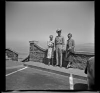 Mertie West, P. F. C. Ernest T. Lewis, and Mrs. Ray Johnson pose in front of a parapet at Crown Point, Corbett, 1942