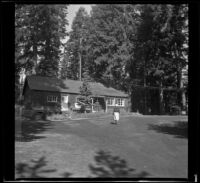 Mertie West walking towards the lodge of Odell Lake Resort, Odell Lake, 1942
