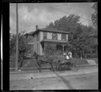 A carriage rides past the Biddick family residence, Burlington, 1900