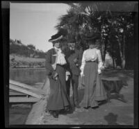 Wilfrid and Harriet Cline and Mary West stand by the reservoir at Elysian Park, Los Angeles, about 1904