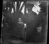 Dr. Bim Smith holds what may be a hamster or gerbil in Lincoln (Eastlake) Park, Los Angeles, 1899