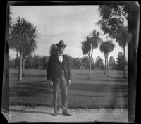 Dr. Bim Smith stands in Lincoln (Eastlake) Park, Los Angeles, 1899