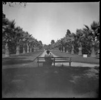 Daisy Kellum sits on a bench in Lincoln (Eastlake Park), Los Angeles, about 1900