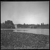 Lake with pagoda on the opposite shore at Lincoln (Eastlake) Park, Los Angeles, about 1900