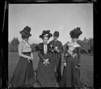 Daisy Connor, Lena Weideman, Ben Tyler, and Mary Dixon stand together in Lincoln (Eastlake) Park, Los Angeles, about 1900