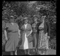 Lettice Chapman Reid, Lena Brigham, Lizzie Ritchie Geddes and Alice Riley Tallman pose at the Pioneer Picnic held in Sycamore Grove Park, Los Angeles, 1940