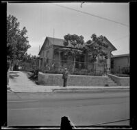 Wilson West stands in front of a house on Daly Street, Los Angeles, 1936