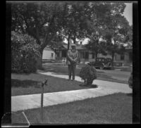 Wilson D. West stands in the front yard of the old West family residence on South Workman Street, Los Angeles, 1936
