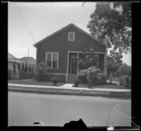 Wilson D. West poses in front of the old West family residence on South Workman Street, Los Angeles, 1936