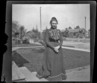 Louise Ambrose poses on her front lawn, Los Angeles, about 1894