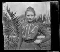 Louise Ambrose poses in front of palm fronds outside her family's home, Los Angeles, about 1894