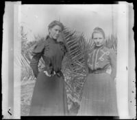 Agnes Ebey and Louise Ambrose pose outside the Ambrose home, Los Angeles, about 1894