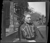 Louise Ambrose poses while sitting on the front steps of the Ambrose home, Los Angeles, about 1894