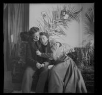 Minnie Kellum and Daisy Kellum sit on their sofa and perform a scene from a play, Los Angeles, about 1899